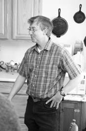 Ken Bigelow stands in the kitchen of the SkyRidge home he shares with his family.  Bigelow worked for a year on his house, using sweat equity to help finance it through a Colorado Housing Inc. program. /Photo by Todd Newcomer