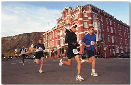 Runners pass the Strater Hotel on their long haul out to the north Animas Valley and back.