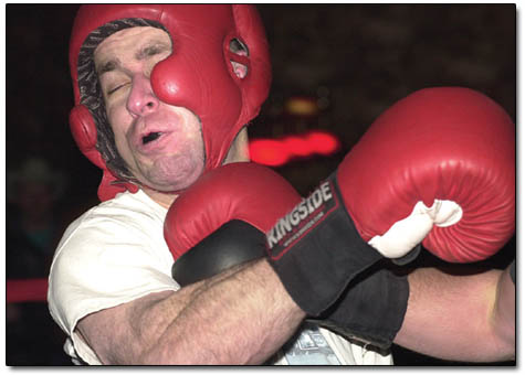 Tom B., a pizza-maker from Durango, takes an upper cut in his losing bout last week at the Wild Horse.