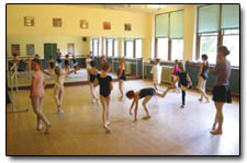 Instructor Erika Wilson looks on as the students of Ballet 1 practice their form.