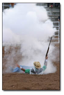 Rodeo clown Bennie Bob  Patrick disappears in a cloud of smoke when a triple richochet shot goes awry.