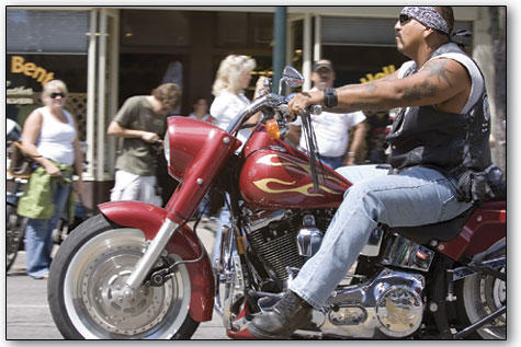 A biker struts his mojo as he travels south down Main Avenue during the parade Sunday in downtown Durango.