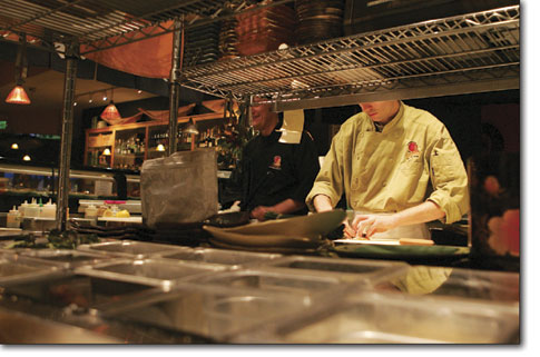 Yarko Thomas, right, works behind the sushi bar at East by Southwest Monday after a busy holiday season in Durango.