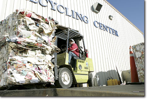 Amos Padilla operates the forklift as he fills a truck with paper, which will be shipped to Snowflake, Ariz., where it will be recycled into new paper products.