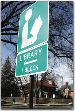 A sign directs traffic towards the Durango Public Library just off E. Third Avenue.