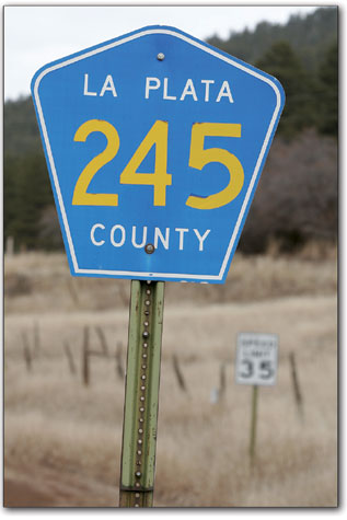 A sign labels County Road 245 east of Durango.