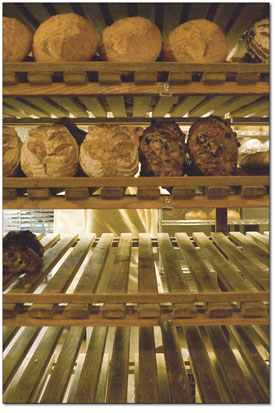 Bernard Castellain organizes the rack of bread loaves.