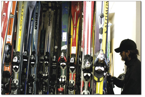 Kelly Hill hangs up a pair of rental skis. Over the past few weeks, more than 1,500 pairs of skis have been tuned in preparation of the coming ski season.