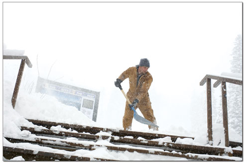 Erick Ireland shovels a set of stairs at Durango Mountain Resort on Tuesday Morning after a foot of fresh snow had fallen.