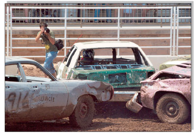 Eli Rubel, of theDurango Herald, gets up close and personal with a few of the drivers during the second heat of the derby.