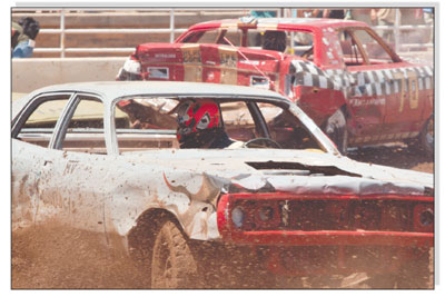 Mud flies as drivers use the back of their cars to inflict the most damage possible while protecting their engines from damage.
