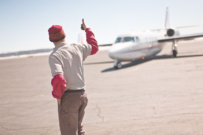 Gus Westerman, with the Durango Jet Center, gives a pilot the OK for taxi Tuesday morning.