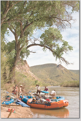 Boaters rig the rafts under a grove of cottonwoods on the last morning of the five-day trip.