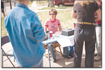 Above: Anne Cheeney, center, fields questions and collects cash from the steady throngs of people who came to the Triple-Super-Duper Bike Sale.