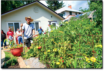 Kynan Kelley explains the roots of his backyard garden on E. 6th Ave.