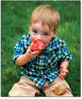 Walker Jones discovers the juicy flavor of a fresh peach.