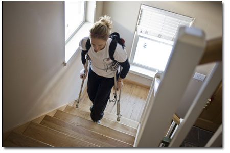 Kristin makes her way up the stairs at a relative's house on Sunday morning. Thankfully, friends and family are at her beckon call during the recovery process.