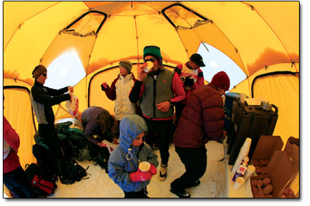 Folks shake off the chill in the dome warming tent near the start/finish line.