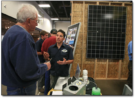 Dusty Bender, of Shaw Solar, explains the inner workings of solar collection.
