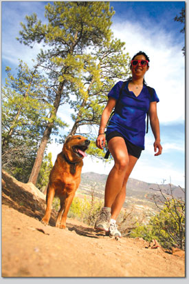Angelina Skowronski and her pup, Emmy Lou, head up the Animas Loop Trail.
