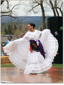 Jen Cossey displays a beautiful dress from the state of Veracruz, Mexico