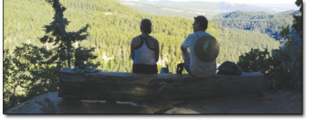 Fellow Colorado Trail users Jayme Varco and Bob Kuhnert soak in the view from Gudys Rest above Junction Creek.