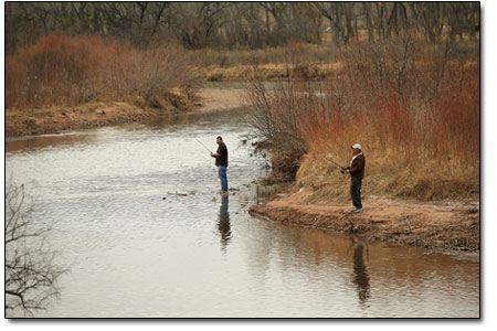 A local pastime, fishing on the Chama River.